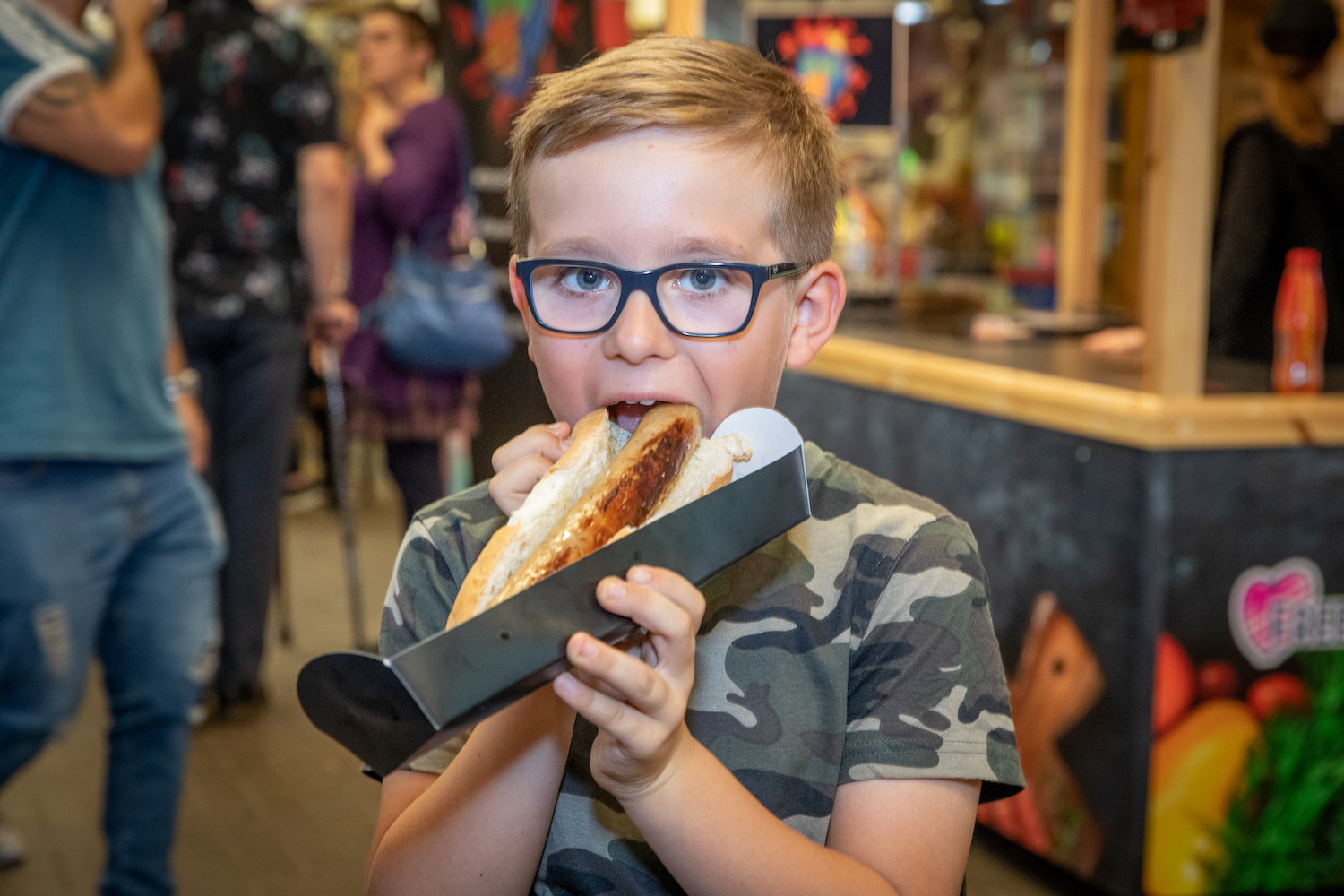 Young Boy Eating A Hot Dog - Freeman St Food Fight Event