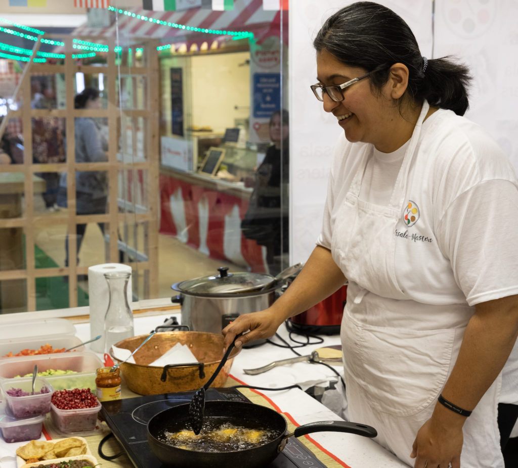 Woman cooking at Freeman Street Market Food Fight Event