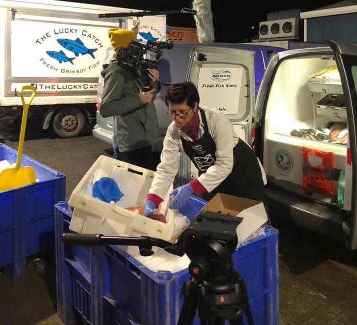Female Fish Merchant and Videographer filming for Start Up event